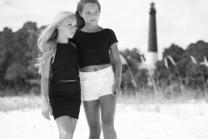 two girls posing in front of Pensacola lighthouse