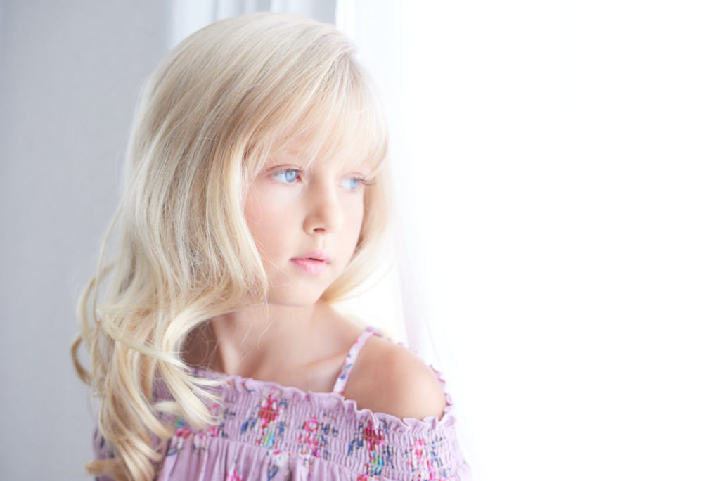 preteen girl model looking out window